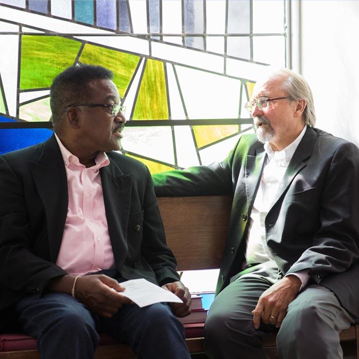 LTSS student talks with professor in Chapel