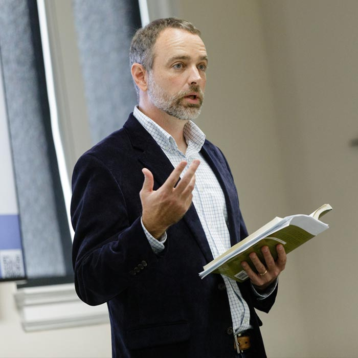 A LTSS professor lectures to students in class