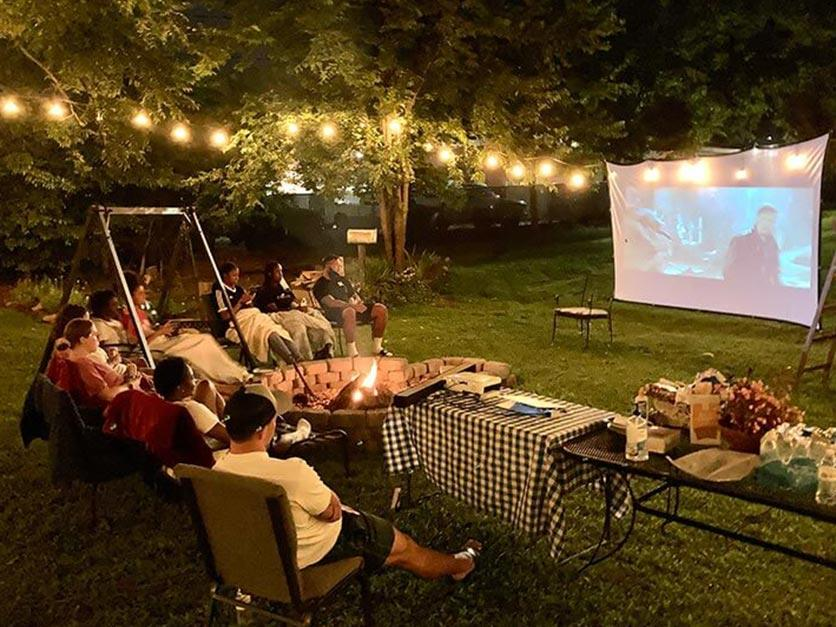 International students enjoying a cookout and movie under the stars.