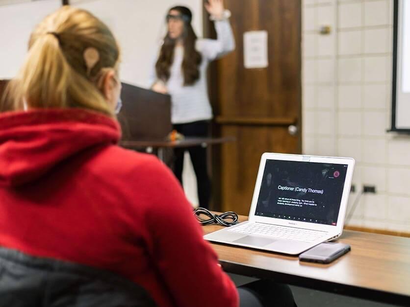 A student utilizes a computer translator.
