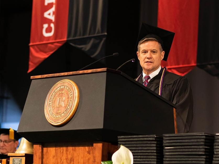 Dr. David Lowry giving a commencement speech.