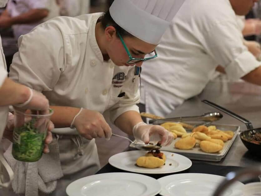 A culinary student prepares a meal.