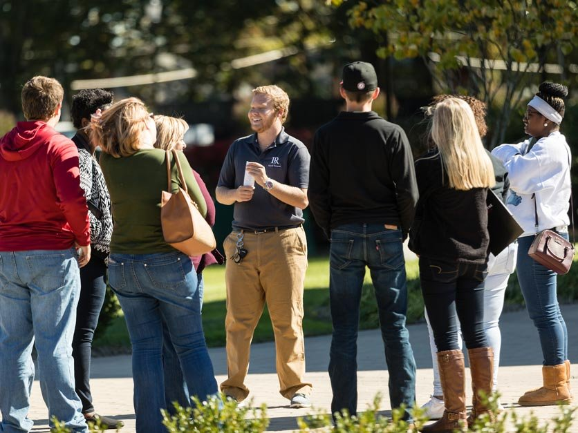 Prospective students and parents take part in a campus tour