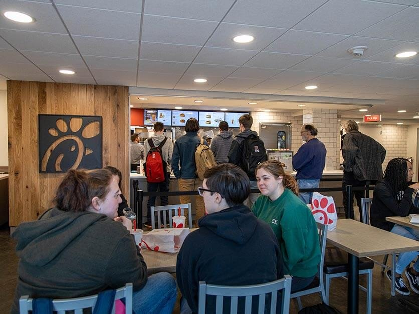 Students eating at the Chick-fil-A restaurant on campus