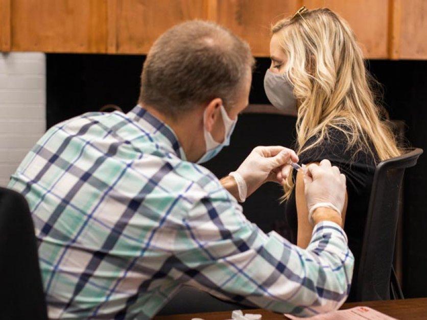 A person gets a flu shot in their arm