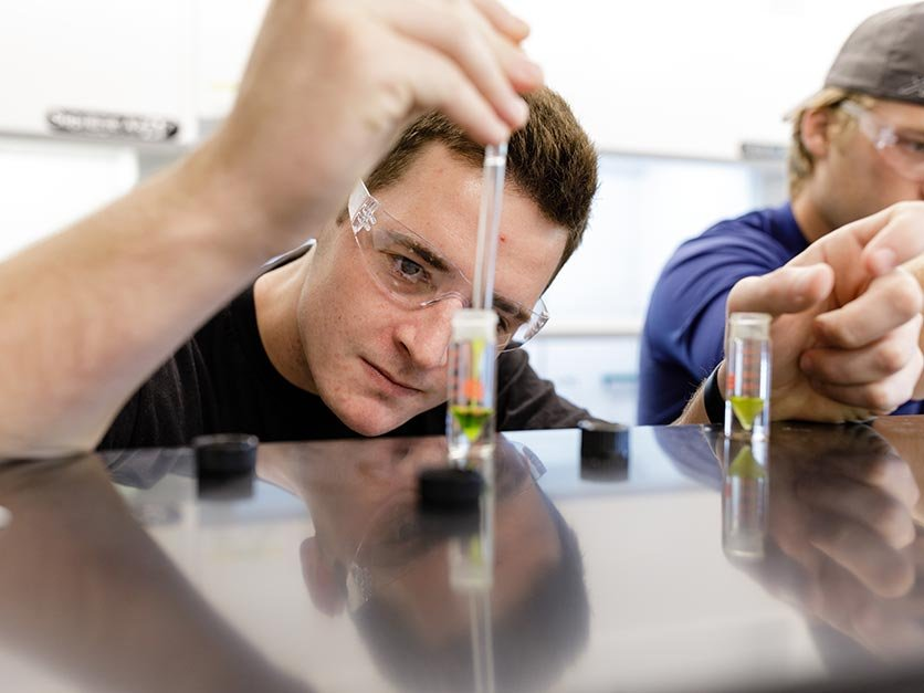 A student measures liquid in a beaker