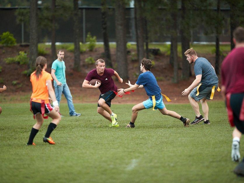 Students play flag football