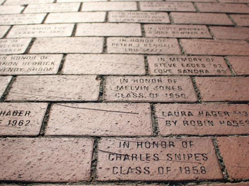 View of bricks inscribed with names of people in walk of honor