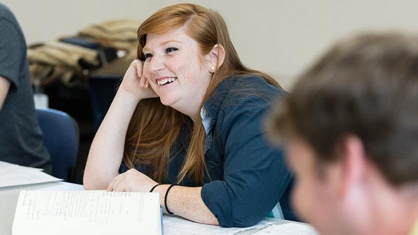 A student smiling in the classroom