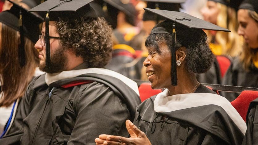 Students sitting in crowd during commencement ceremony